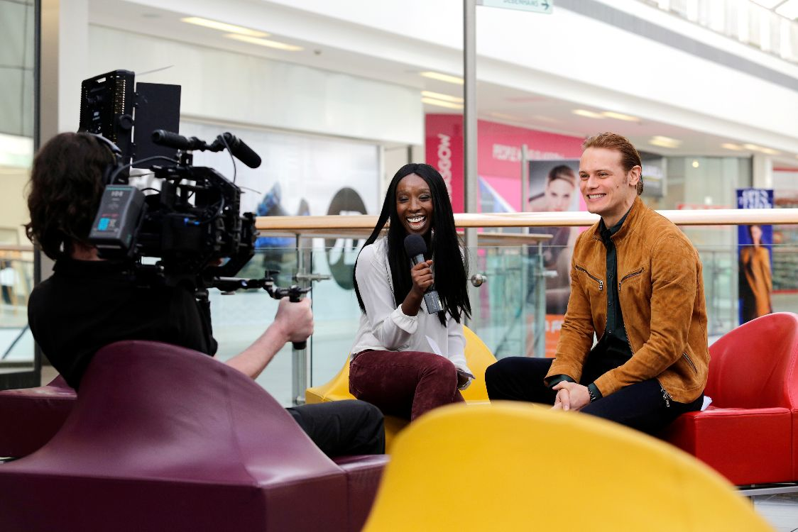 Sam Heughan being interview by Eunice Olumide