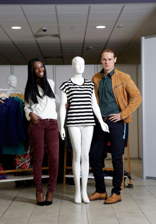 Eunice Olumide & Sam Heughan in the empty shop with a mannequin